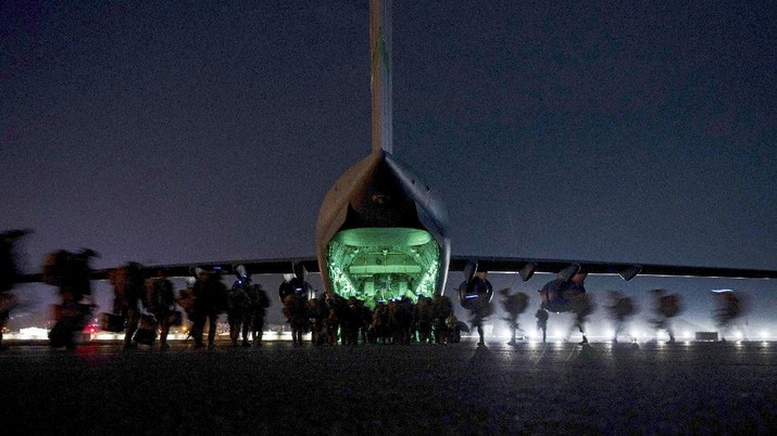 In this Aug. 30, 2021, photo provided by the U.S. Air Force, soldiers, assigned to the 82nd Airborne Division, prepare to board a U.S. Air Force C-17 Globemaster III aircraft at Hamid Karzai International Airport in Kabul, Afghanistan. (Senior Airman Taylor Crul/U.S. Air Force via AP)