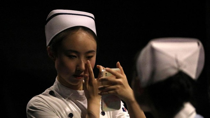 A model waits backstage before a fashion show with creations for medical professionals, designed by the Beijing Institute of Fashion Technology in collaboration with Dishang, during China Fashion Week in Beijing, China September 11, 2021. REUTERS/Tingshu Wang