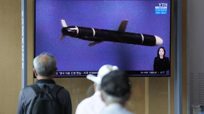 People watch a TV screen showing a news program reporting about North Korea's long-range cruise missiles tests with images in Seoul, South Korea, Monday, Sept. 13, 2021. North Korea says it successfully test fired newly developed long-range cruise missiles over the weekend, its first known testing activity in months, underscoring how it continues to expand its military capabilities amid a stalemate in nuclear negotiations with the United States. The letters read,