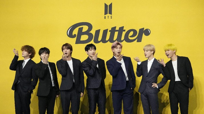 FILE - In this May 21, 2021, file photo members of South Korean K-pop band BTS pose for photographers ahead of a press conference to introduce their new single