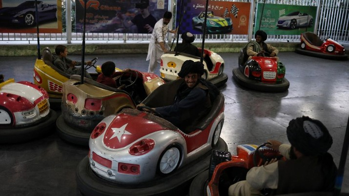 Taliban soldiers ride bumper cars in an amusement park in Kabul, Afghanistan, September 13, 2021. WANA (West Asia News Agency) via REUTERS ATTENTION EDITORS - THIS IMAGE HAS BEEN SUPPLIED BY A THIRD PARTY.