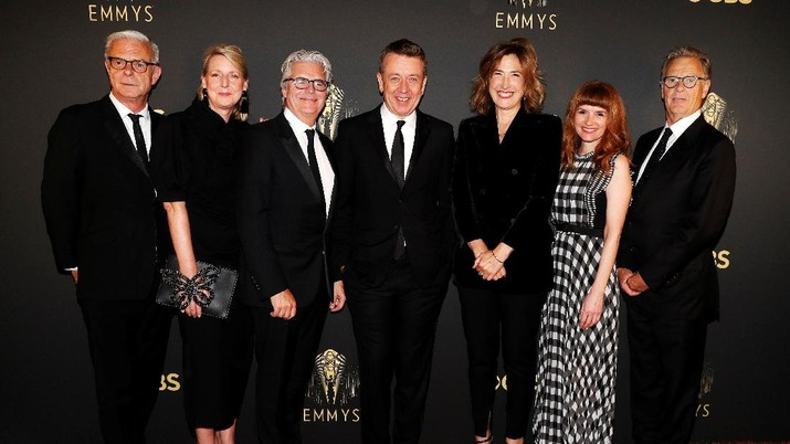Showrunner Peter Morgan, Director Jessica Hobbs, Executive Producers Stephen Daldry, Robert Fox, Matthew Byam Shaw and Suzanne Mackie, and Producer Oona O'Beirn, pose at the Netflix UK Primetime Emmy Red Carpet for