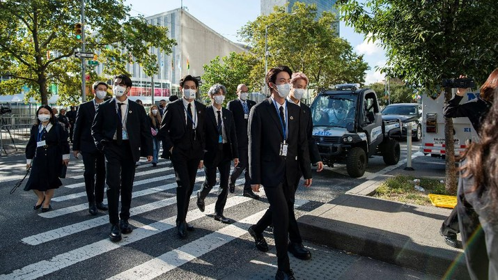 Members of the South Korean band BTS walk near the United Nations headquarters during the 76th Session of the United Nations General Assembly in Manhattan, New York, U.S., September 20, 2021. REUTERS/Eduardo Munoz