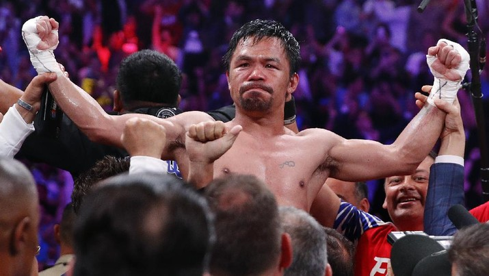 FILE - Manny Pacquiao reacts after defeating Keith Thurman by split decision in a welterweight title fight in Las Vegas, in this Saturday, July 20, 2019, file photo. Pacquiao could have canceled his comeback from a two-year ring layoff when Errol Spence Jr. dropped out less than two weeks before their Aug. 21 fight. Instead, the Filipino congressman gave a career-defining opportunity to Yordenis Ugás, a Cuban veteran who now has the welterweight title belt Pacquiao recently held. (AP Photo/John Locher, File)