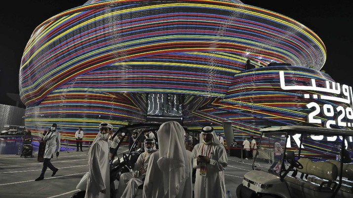 People visit the Russia pavilion during the first day of the Dubai Expo 2020 in Dubai, United Arab Emirates, Friday, Oct, 1, 2021. (AP Photo/Kamran Jebreili)