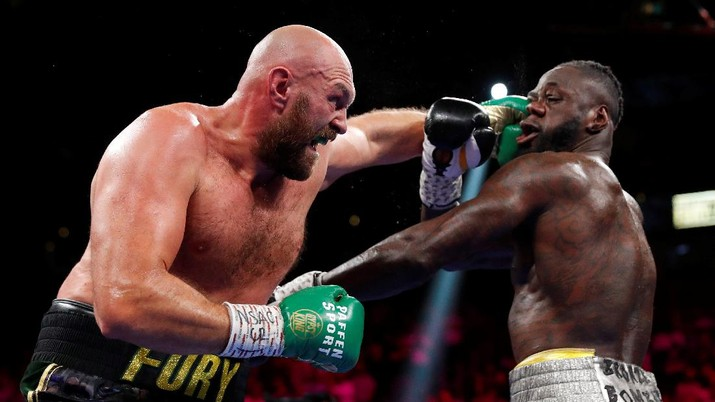 Boxing - Tyson Fury v Deontay Wilder - WBC Heavyweight Title - T-Mobile Arena, Las Vegas, Nevada, U.S. - October 9, 2021  Tyson Fury in action against Deontay Wilder REUTERS/Steve Marcus     TPX IMAGES OF THE DAY