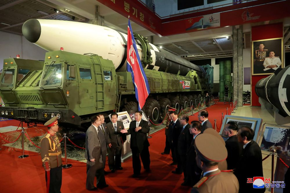 North Korea's leader Kim Jong Un speaks to officials next to military weapons and vehicles on display, including the country's intercontinental ballistic missiles (ICBMs), at the Defence Development Exhibition, in Pyongyang, North Korea, in this undated photo released on October 12, 2021 by North Korea's Korean Central News Agency (KCNA).   KCNA via REUTERS    ATTENTION EDITORS - THIS IMAGE WAS PROVIDED BY A THIRD PARTY. REUTERS IS UNABLE TO INDEPENDENTLY VERIFY THIS IMAGE. NO THIRD PARTY SALES. SOUTH KOREA OUT. NO COMMERCIAL OR EDITORIAL SALES IN SOUTH KOREA.     TPX IMAGES OF THE DAY