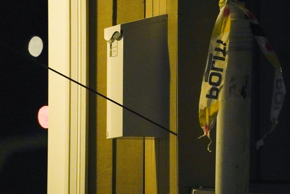 An arrow is seen in the wall after an attack in Kongsberg, Norway, Wednesday, Oct. 13, 2021. Several people have been killed and others injured by a man armed with a bow and arrow in a town west of the Norwegian capital, Oslo. (Terje Bendiksby/NTB Scanpix via AP)